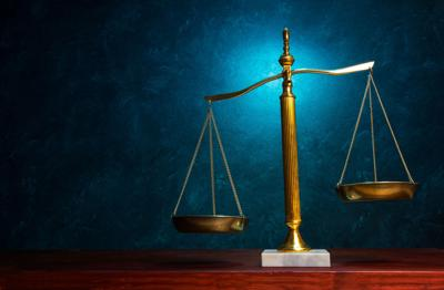 Scales of Justice on blue textured background