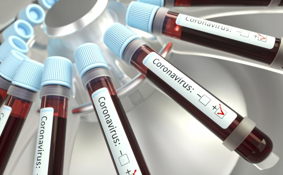 Coronaviruses research, conceptual illustration. Vials of blood in a centrifuge being tested for coronavirus infection.conceptual illustration
