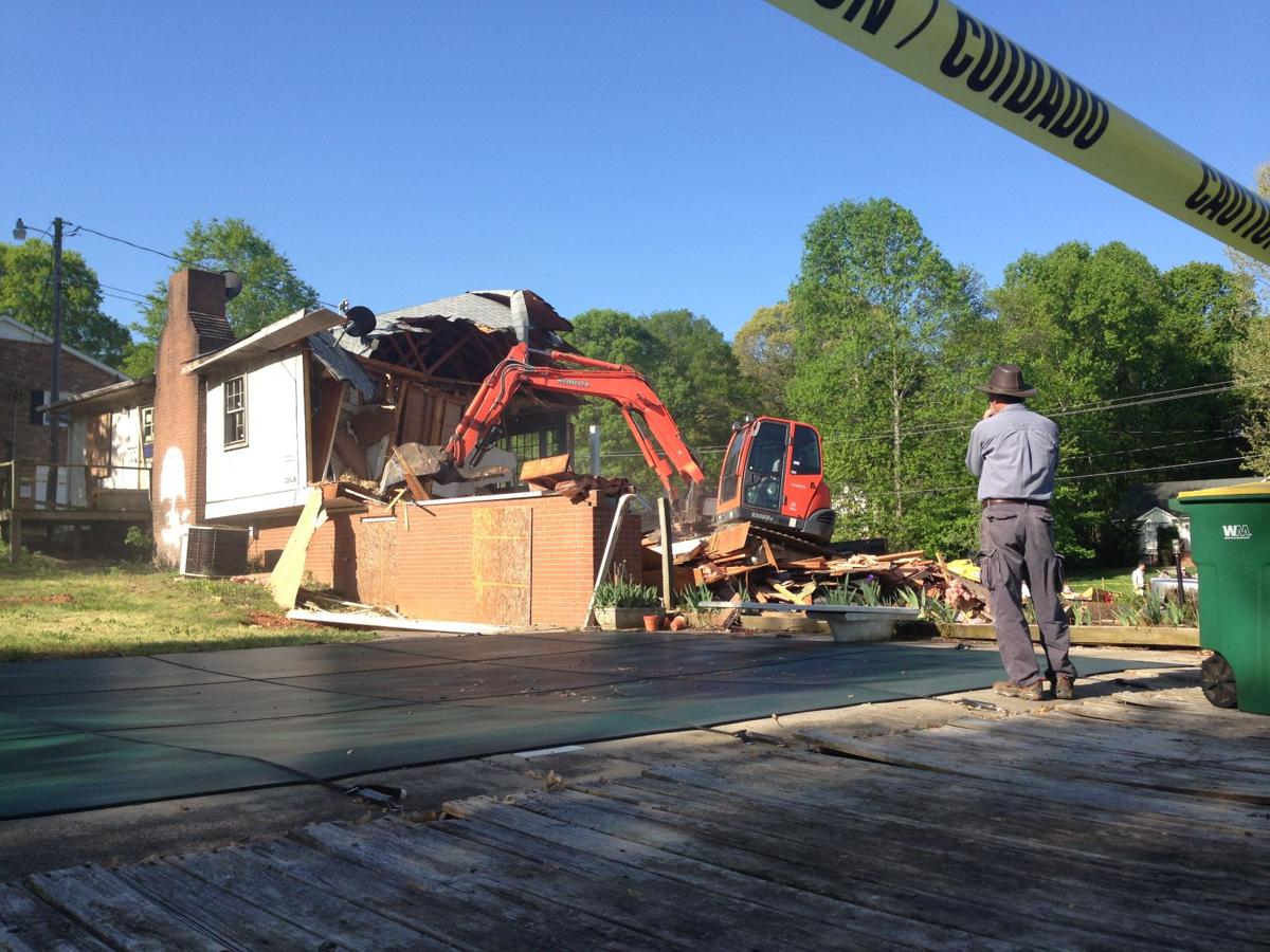 Neighbor watches as Clemmons house is demolished