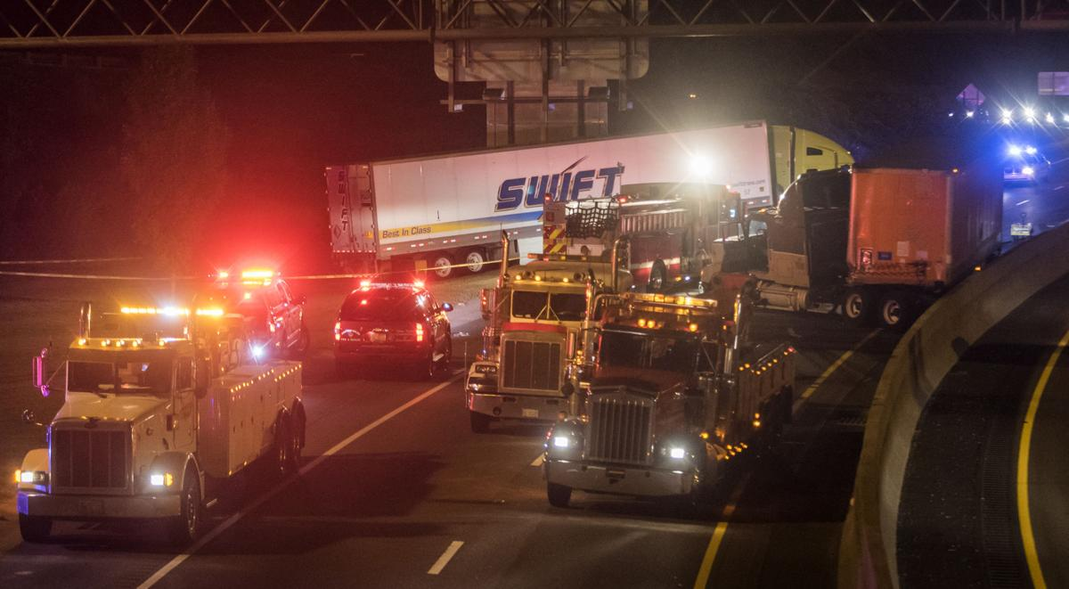 Driverless tractor trailer crosses busy street, slides down to