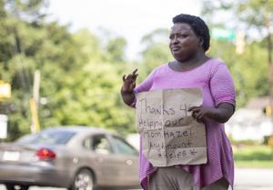 Daughter panhandles in Greensboro to raise money for mother's funeral