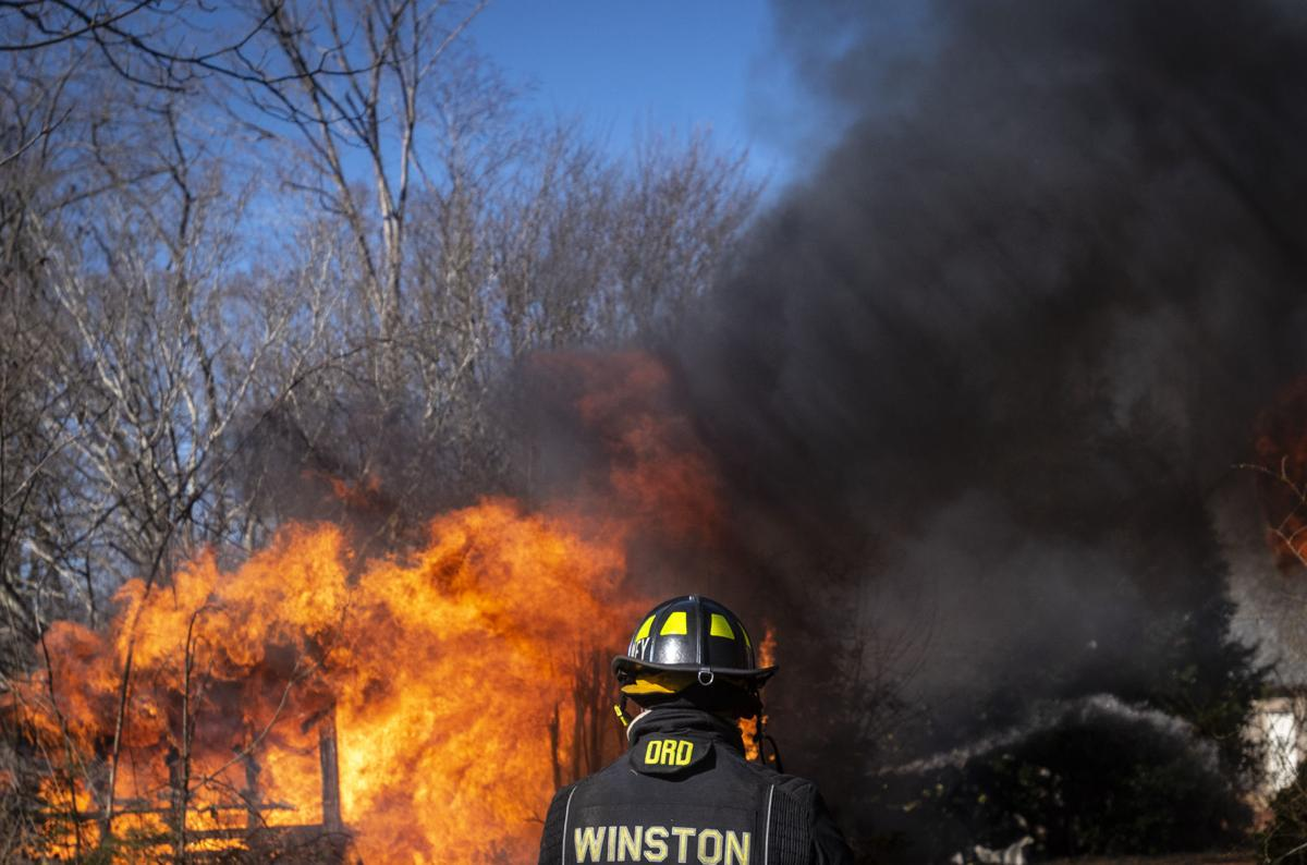 Fire recruits get hands-on training burning house in real