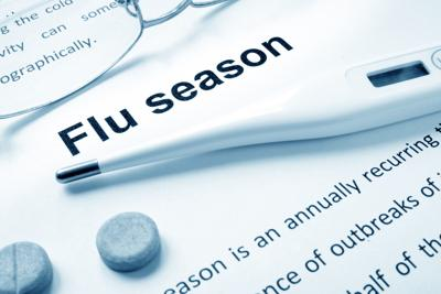 Flu season sign on a paper and glasses