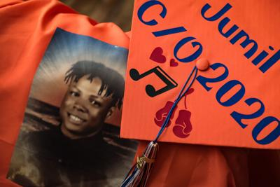 Nakeshia Collins accepts Glenn diploma for son Jumil Robertson