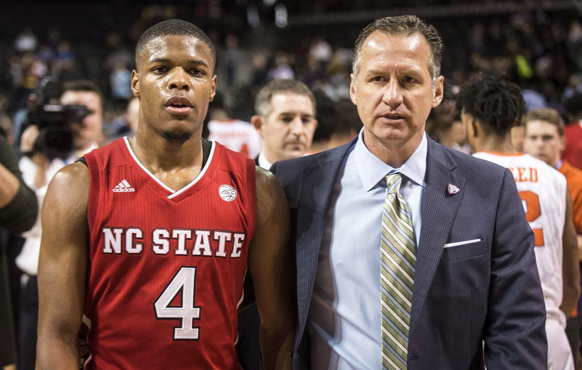 new arrival a3e13 aac8c An FBI investigation alleges that  40,000 was funneled to the family of  former N.C. State guard Dennis Smith Jr.