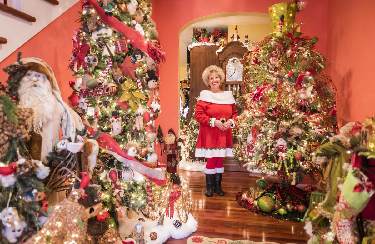 5a9931dbcd551 Christmas. Jeannie Harrison poses among the numerous holiday decorations ...