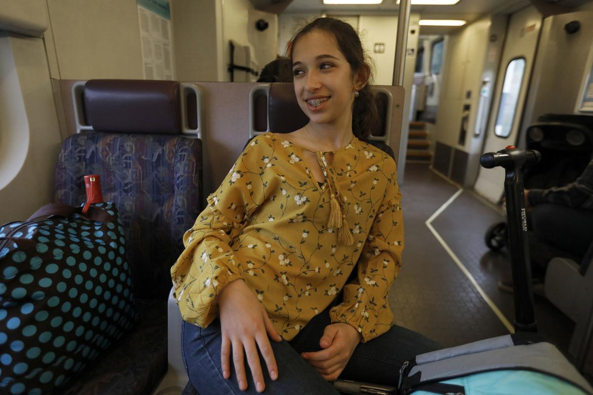 California State University, Los Angeles student Mia Turel, 13, is all smiles after class as she takes the train home after school in Los Angeles on February 12, 2019. She participates in the The Early Entrance Program.