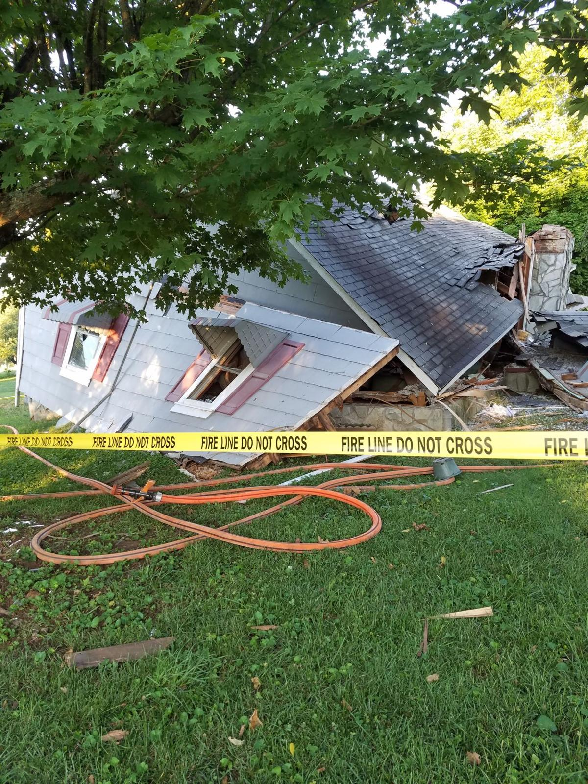 Gas leak explosion knocks out wall, causes partial collapse of home