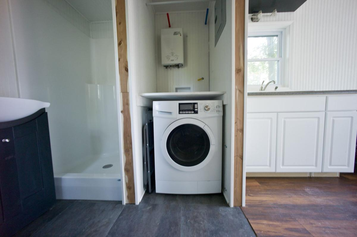 Tiny houses raise big questions for regulators in winston for Tiny house washer dryer
