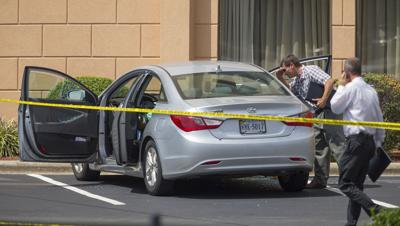 Police investigate body found at Holiday Inn in Greensboro