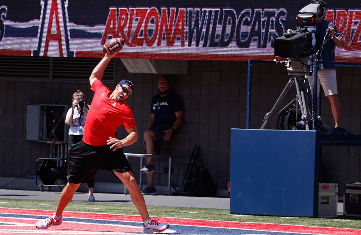 NFL athlete and University of Arizona Alum, Rob Gronkowski spikes the football in the end-zone while coaching Team Red to victory in the Arizona Spring game at Arizona Stadium on April 24, 2021 in Tucson, Arizona.
