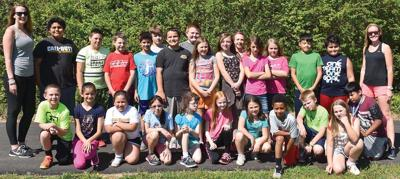 "MORAVIAN FALLS ELEMENTARY ""Girls on the Run"" and ""Let Me Run"" participants are pictured with their coaches, Caitlin Pitkin, boys assistant coach, left and Belinda Marino, right, girls head coach. Not pictured is Sara Webster, boys head coach."