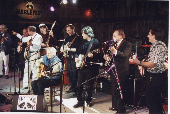 Doc Watson surrounded by banjos