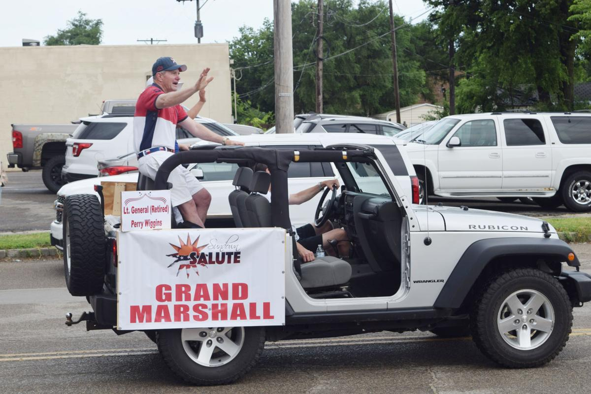 Parade participants show red, white and blue themes