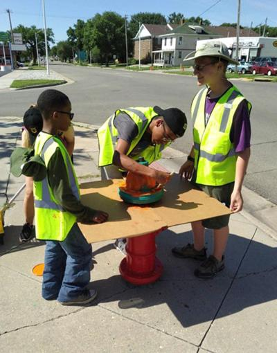 Local Boy Scouts paint hydrants to help firefighters