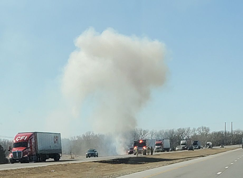 Fire south of east bound lane on I-70