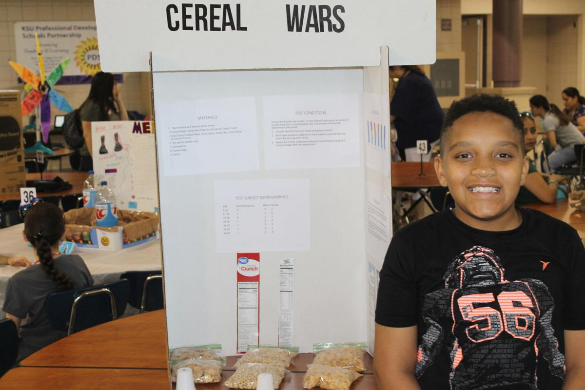 STEM Fair participants conduct experiments on different cereal brands, dirty mouths and balloon-induced travel