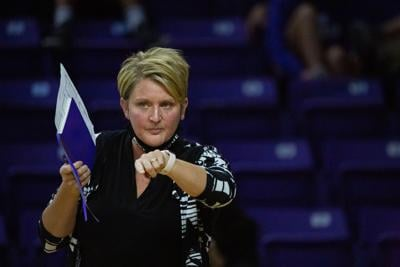 Suzie Fritz, head coach, redirects players between rounds. K-State Volleyball faced Iowa State on Saturday night beating out Iowa 3-1 sets at Bramlage Coliseum.