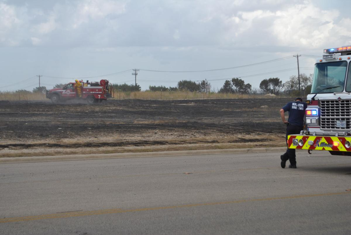 Fire burns open field in south killeen local news kdhnews firefighters douse hot spots at a fire that broke out on the south side of killeen on sunday aug 5 2018 malvernweather Choice Image