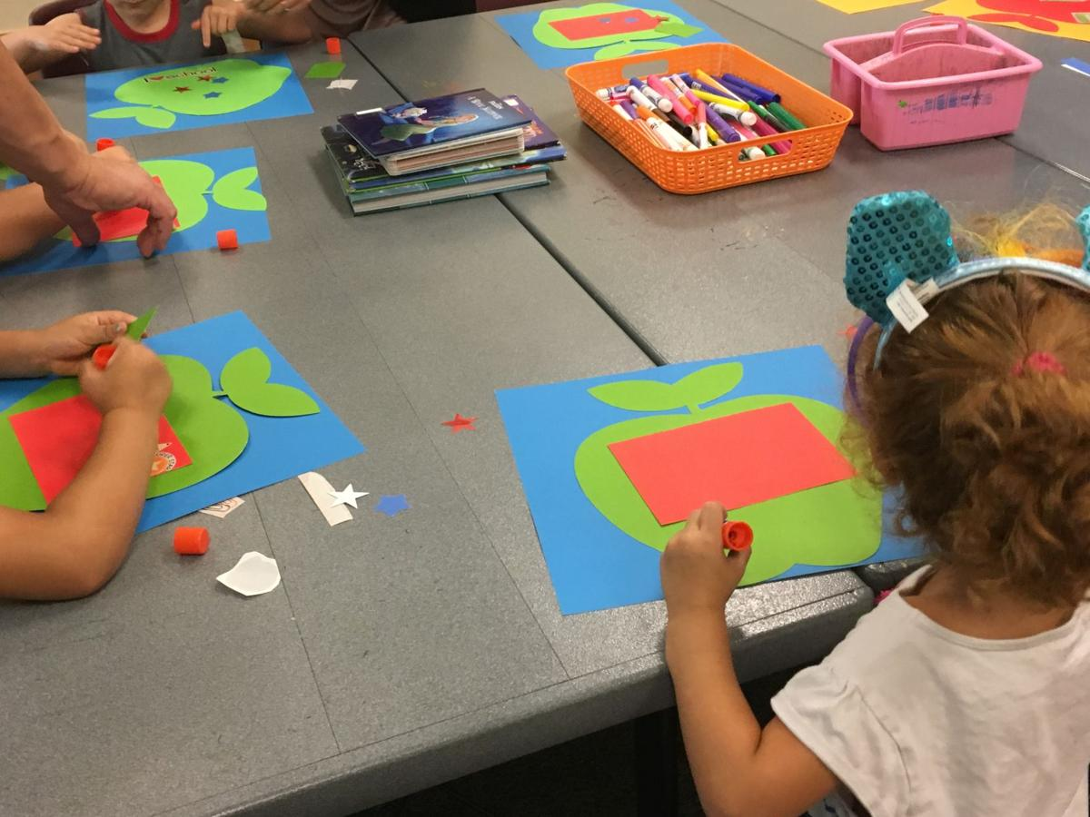 PC Club1-Children get started on their back-to- school projects.JPG