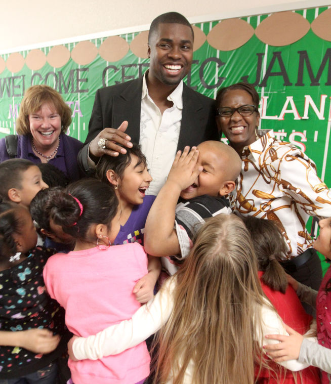 Giving back: Former NFL player visits KISD school