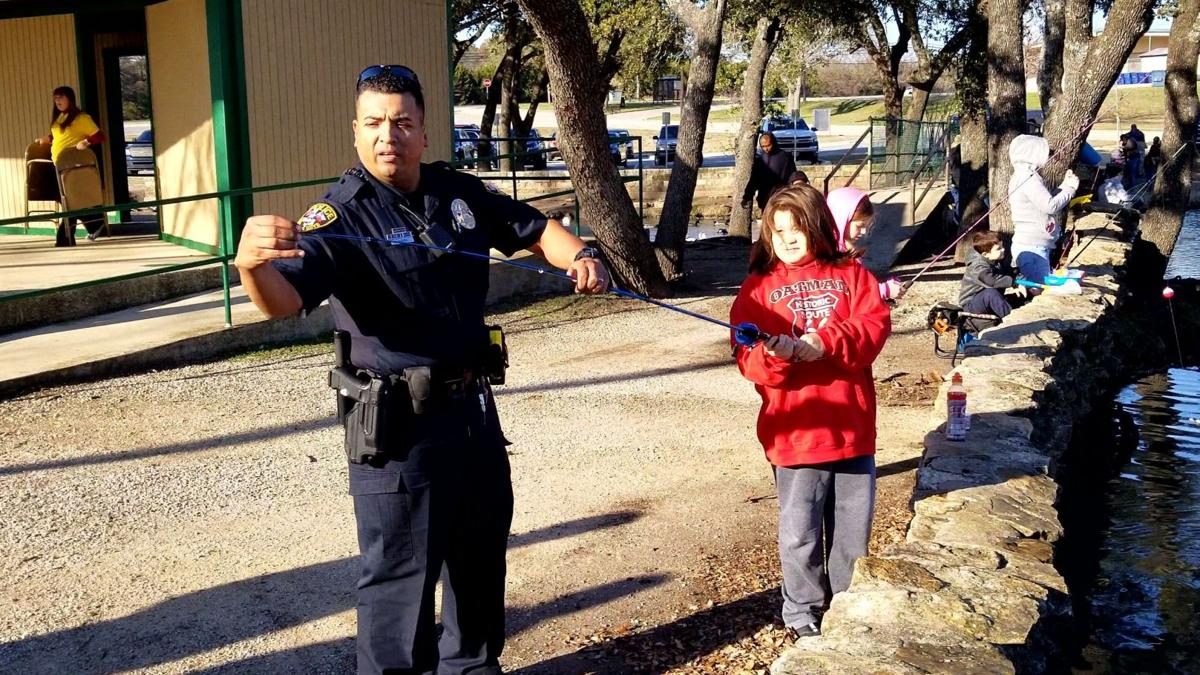 Kids, adults try to land a big one at Cove's Fishing in the Park event