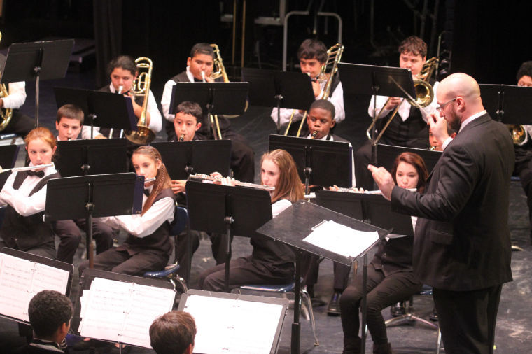 S.C. Lee Junior High Wind Symphony performs in Cove