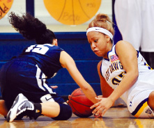 Lady Dawgs roll past young Lady Wolves