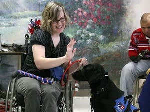 Service dogs graduate from prison