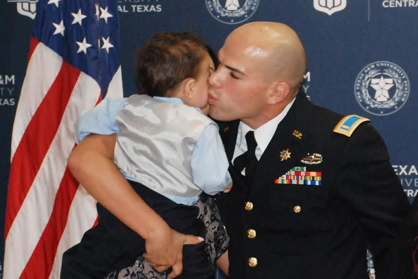 Marvelous Commissioned Active Duty Military Intelligence Officer 2nd Lt. Ricardo  Medina Sanchez Kisses His Son After His Ceremonious Pinning.