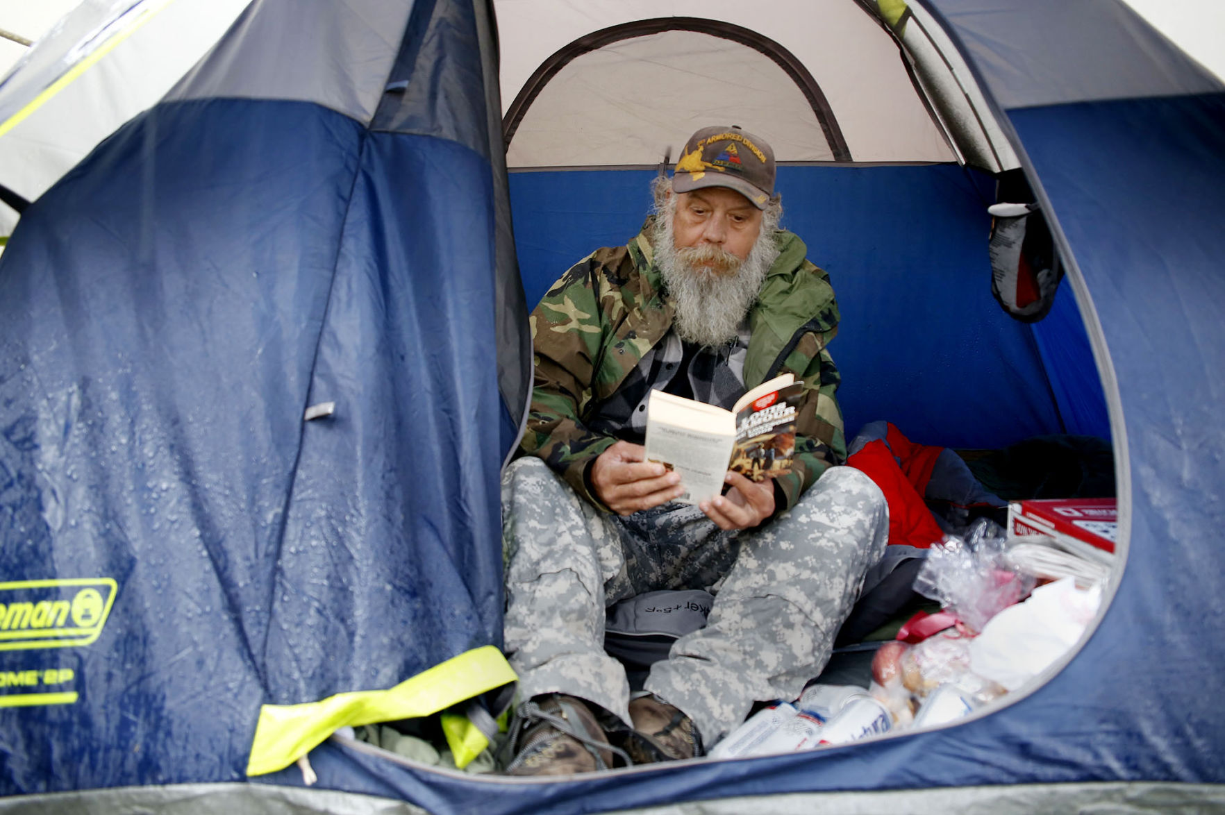 Army veteran Jon Mills reads a book inside of his tent outside of the Copperas Cove Soup Kitchen Friday Jan. 13 2017. Mills has been homeless for about ...  sc 1 st  Killeen Daily Herald & Cove veteran living in tent puts a face on upcoming homeless count ...