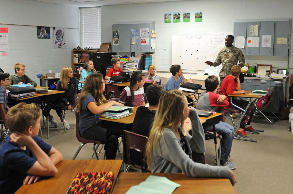 Brave Rifles visit Leander school