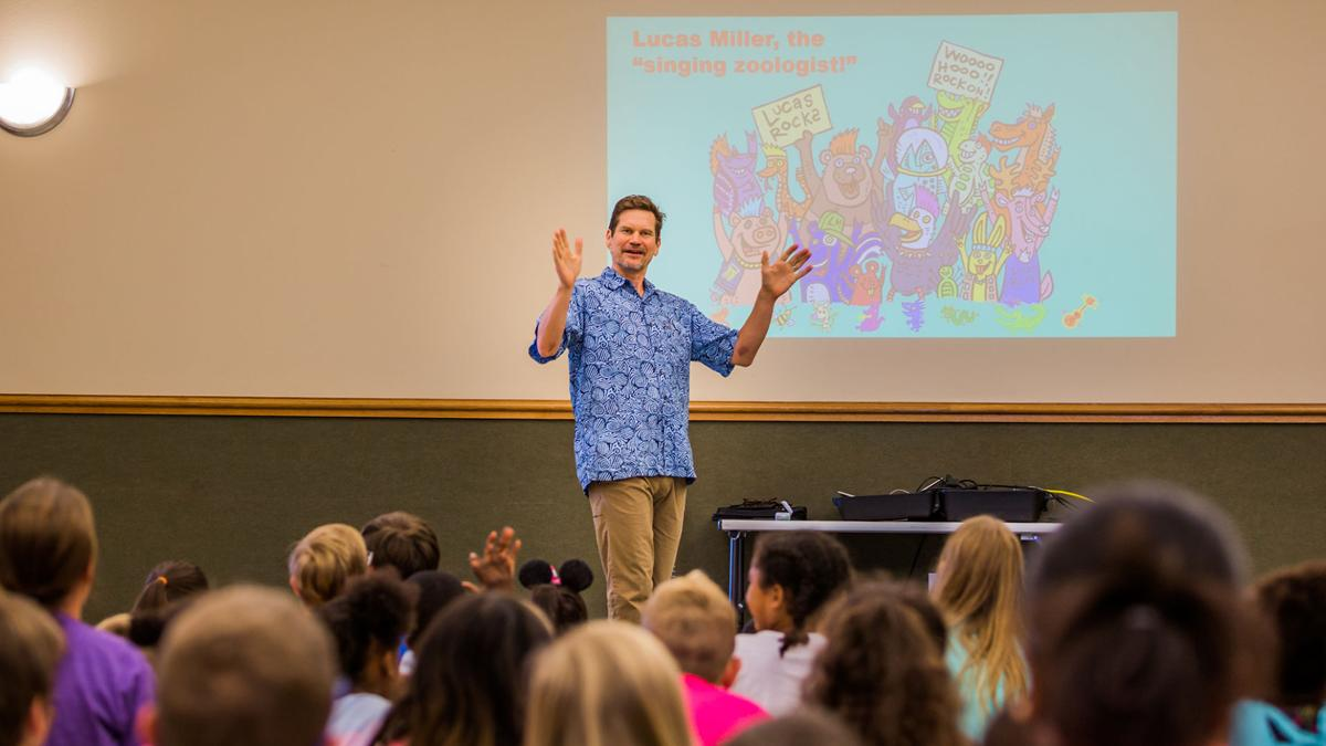 Singing Zoologist entertains children and adults at Heights library