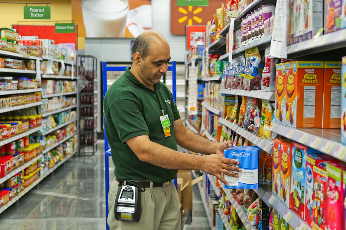 babar shahzad merchandise supervisor stocks shelves thursday at the new harker heights wal mart neighborhood market which is scheduled to open oct 1