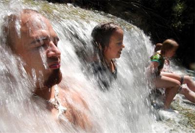 Area residents enjoy the water at Chalk Ridge Falls