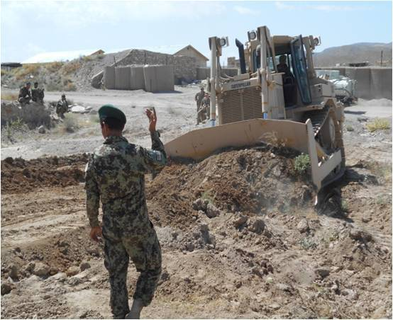 Afghan National Army soldier guides bulldozer