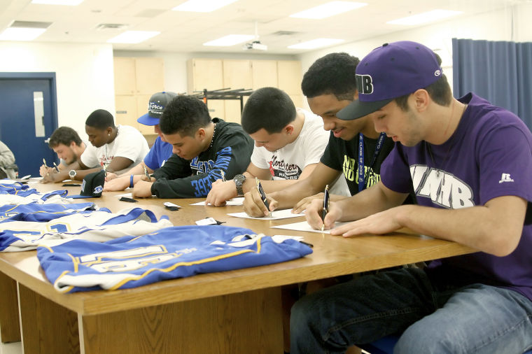 Eight Cove athletes sign letters of intent