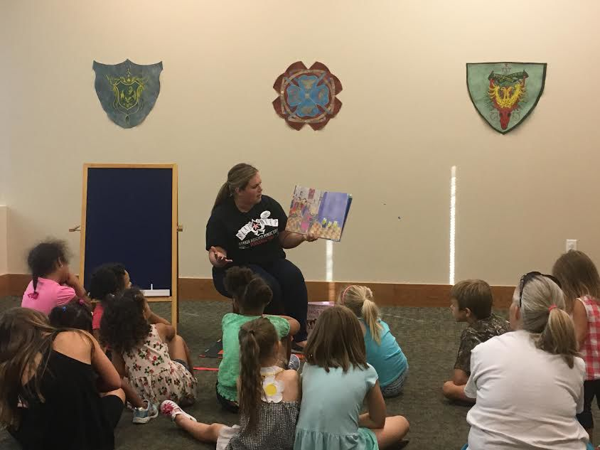 Children gather around Amanda Hairston for story time.jpg