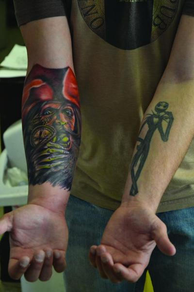 90970f6b7 A soldier shows two tattoos at Calaveras Tattoo Studio in Killeen in March.