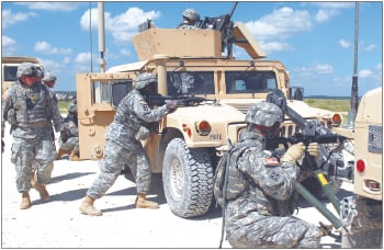 Support troops work as team during live-fire convoy training