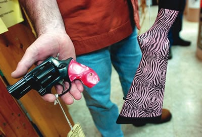 Retailers say military influence drives gun sales