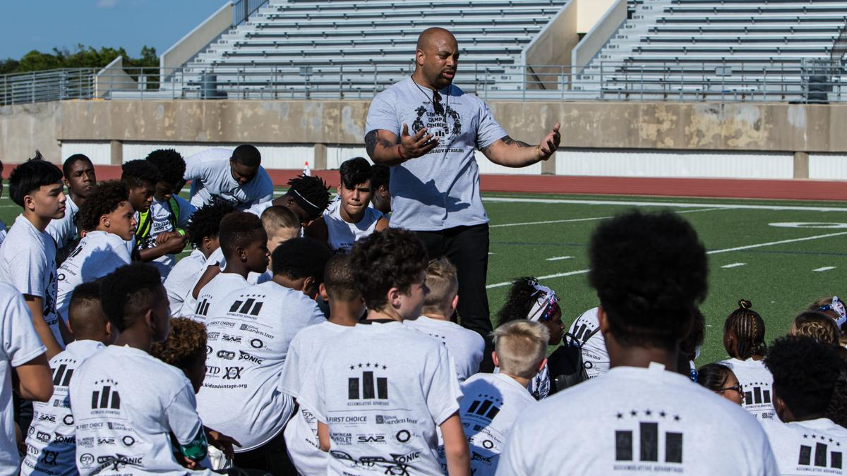 Area football stars return to inspire a future generation at annual camp
