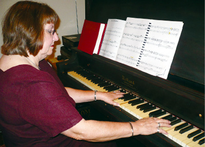 Pidcoke church pianist produces joyful strains on little country church's century-old grand piano