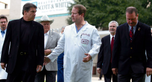 Perry visits wounded