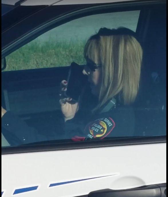 Cop on Phone 2