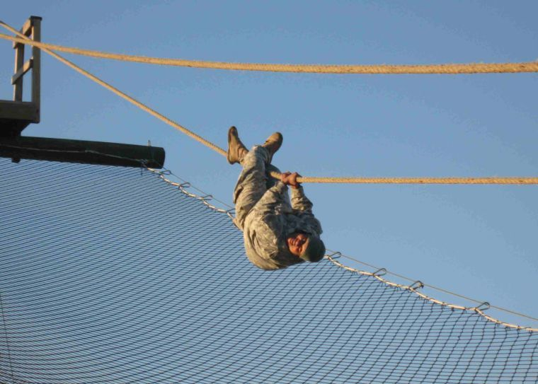479th FA soldiers overcome obstacles for PT