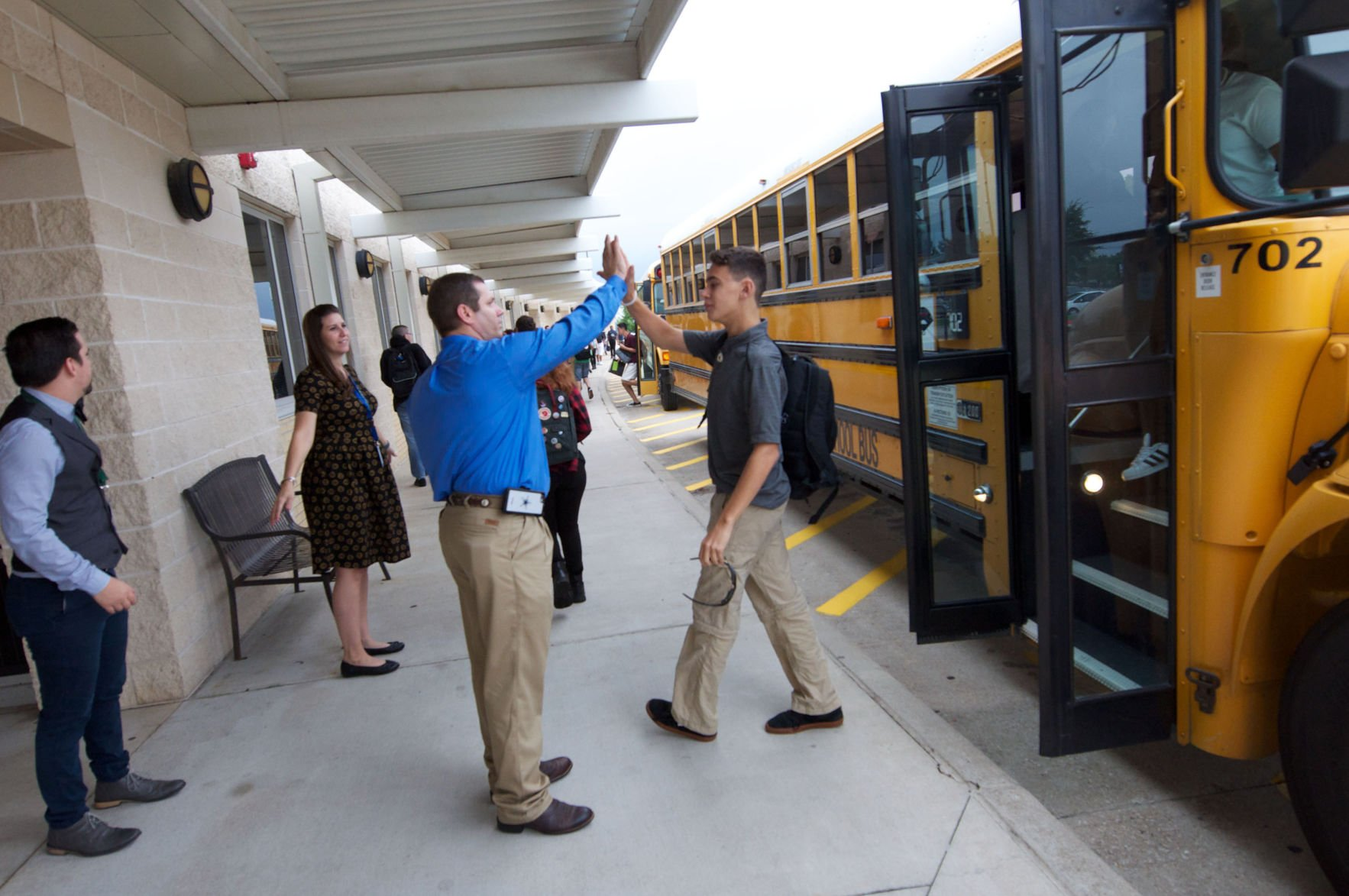Middle School Principal Chad Wolf greets students