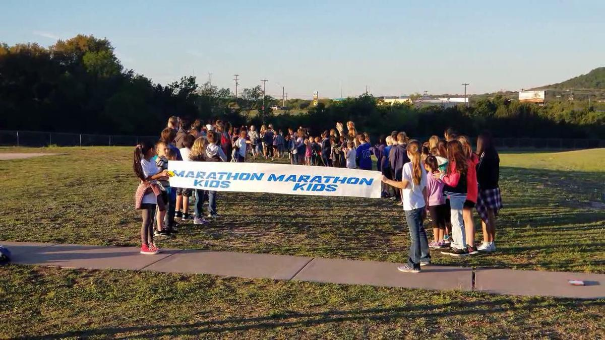 Taylor Creek student completes 1,000th mile in running club