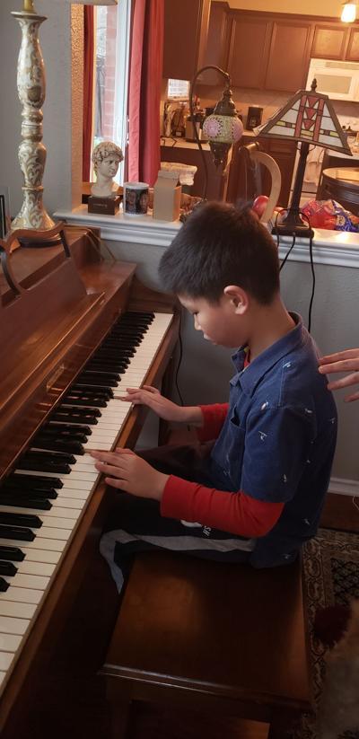 Tusan at piano.jpg