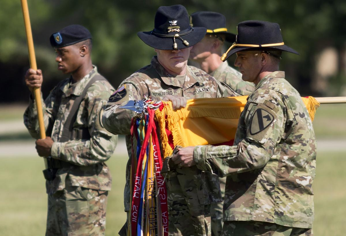 1789c96d4e4c5 1st Cavalry Division soldiers case colors for deployment to Europe ...